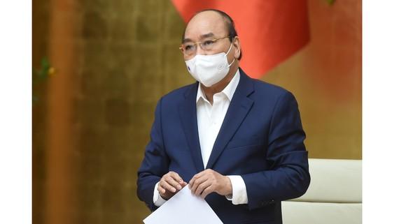 Thủ tướng Nguyễn Xuân Phúc đề nghị tạo mọi điều kiện cho kinh tế tư nhân yên tâm đầu tư, kinh doanh. Ảnh: VGP
