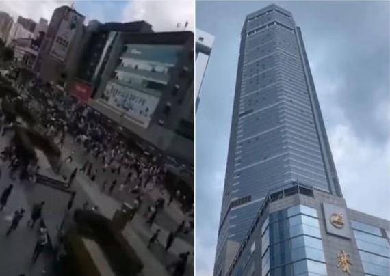 Tòa nhà chọc trời rung chuyển và những người đi bộ sợ hãi bỏ chạy trên đường phố bên ngoài. (Ảnh chụp màn hình Youtube)