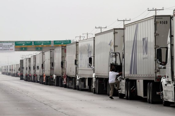 Trucks waited in a long queue for border customs control to cross into U.S. at the World Trade Bridge in Nuevo Laredo, Mexico, earlier this year. PHOTO: DANIEL BECERRIL/REUTERS