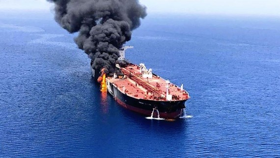 An oil tanker is on fire in the sea of Oman on June 13: Asian governments must quickly assess the threat and respond.   © AP