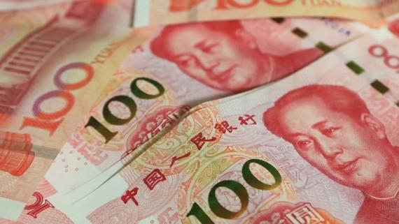 China sets yuan midpoint at new 11-1/2-year low