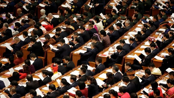 Delegates attend the opening session of the National People's Congress at the Great Hall of the People in Beijing in March 2019: A delay due to the coronavirus outbreak is unlikely to affect fiscal policy much.   © Reuters