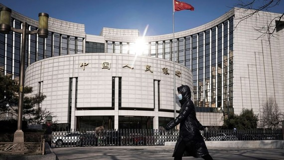 """The People's Bank of China in Beijing. Authorities in the country are taking measures to address uncertainty caused by the coronavirus. Loan defaults arising from the virus will not be included in nonperforming loans for a """"grace"""" period.   © Reuters"""