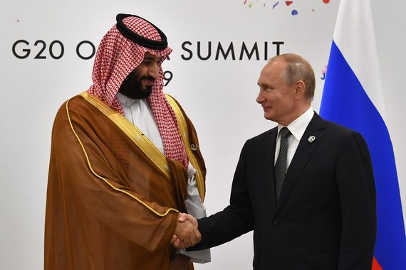 Vladimir Putin, right, shakes hands with Mohammed bin Salman on the sidelines of the G20 Summit in Osaka in 2019.Photographer: Yuri Kadobnov/AFP via Getty Images