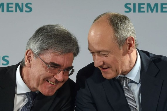 The leadership transition will be gradual, the company said, with Deputy CEO Roland Busch, right, taking on more responsibilities from CEO Joe Kaeser, left. PHOTO: CHRISTOF STACHE/AGENCE FRANCE-PRESSE/GETTY IMAGES