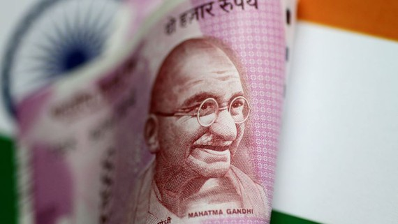 The Indian rupee fell to its lowest value against the dollar on record Thursday due to economic fallout concerns.   © Reuters