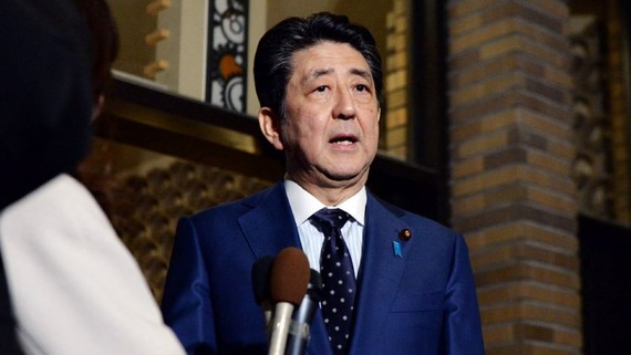 Japanese Prime Minister Shinzo Abe speaks to reporters at the prime minister's office in Tokyo after a phone call with International Olympic Committee President Thomas Bach on Tuesday. (Photo by Arisa Moriyama)