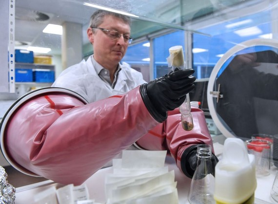 Doctor Philip Supply, Research Director for the CNRS, holds the original test tube containing the strain of Bacillus Calmette Guerin in France, on March 22. Photographer: Denis Charlet /AFP via Getty Images