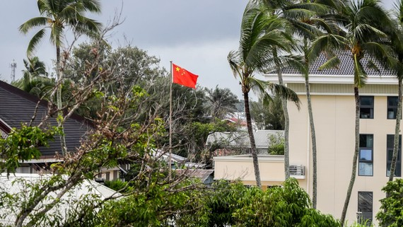 A Chinese flag flies outside the Chinese Embassy in Nuku'alofa, Tonga. China is pouring billions of dollars in aid and low-interest loans into the South Pacific, as part of a battle for power and influence in the region.   © AP