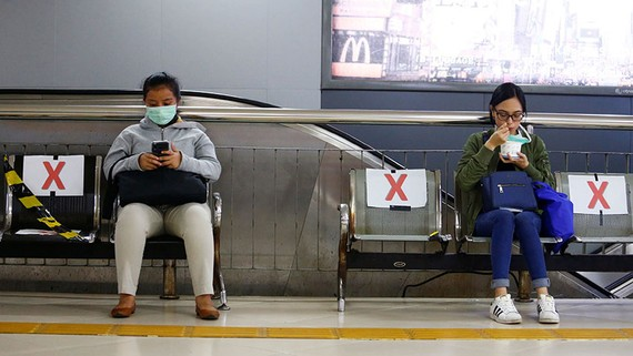 Benches at a station in Jakarta have been marked off to encourage social distancing.   © Reuters
