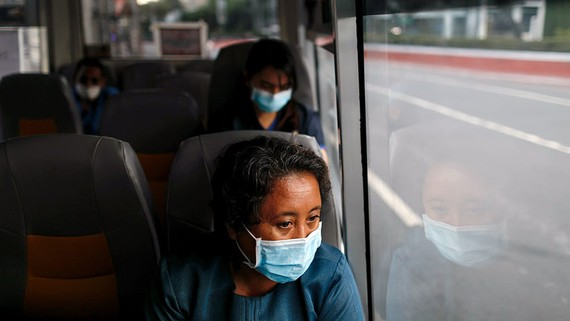 Medical workers ride a shuttle bus in Manila: Thousands leave the country every year to work overseas.   © Reuters