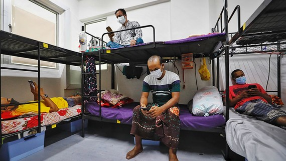 Singapore has about 1.4 million foreign workers, many of whom live with thousands of others in cramped dormitories that offer little personal space. (Courtesy of Singapore's Ministry of Manpower)