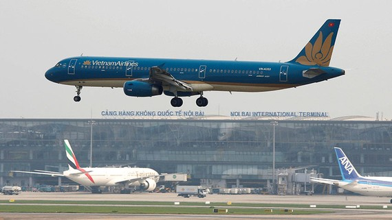 A Vietnam Airlines plane lands at Noi Bai airport in Hanoi. The carrier has suspended international service and slashed domestic flights.   © Reuters