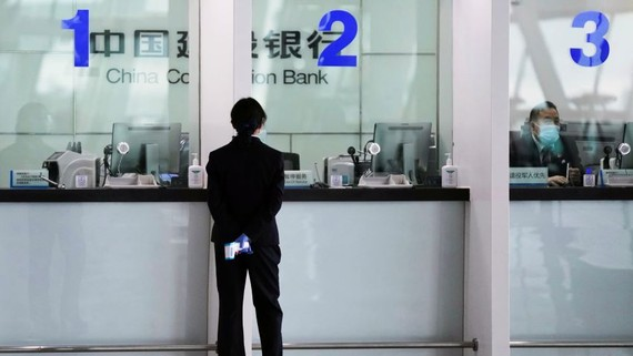 A branch of China Construction Bank in Wuhan. Data shows a lot of Chinese bank lending is not finding its way into the real economy as businesses and households hoard cash   © Reuters