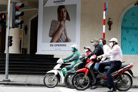 Stores in Hanoi began reopening Thursday after Vietnam eased three-week-old restrictions on movement. PHOTO: KHAM/REUTERS