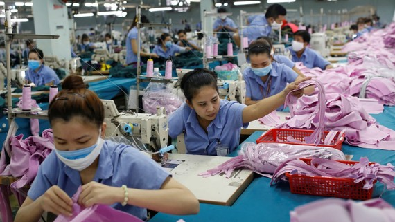 Workers piece together clothes at a factory in Ho Chi Minh City. Vietnam ranks as the world's third-largest apparel exporter.   © Reuters