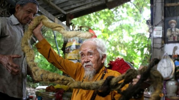 Nguyen Van Chien, 92, sits for a portrait to show his 5m long hair, which he said has not been cut for nearly 70 years, at his home in Tien Giang province, Vietnam, on Aug 21, 2020. (Photo: REUTERS/Yen Doung)