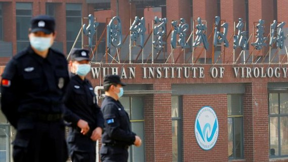Security personnel outside the Wuhan Institute of Virology during a visit by the World Health Organisation in February. US intelligence officials are investigating whether the facility could have played a role in the origins of Covid-19. © Thomas Peter/RE
