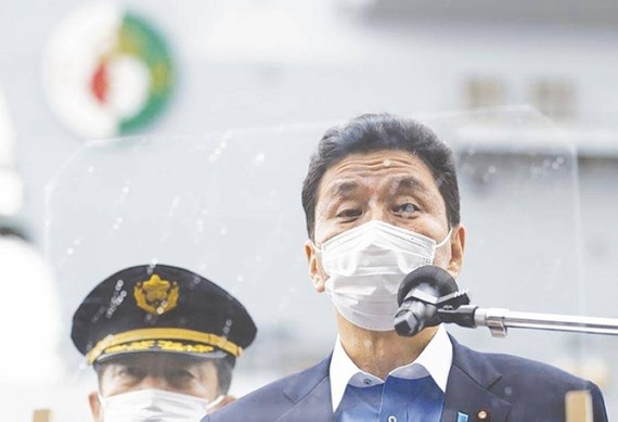 ASIAN POWER In this Sept. 6, 2021 file photo, Japan's Defense Minister Nobuo Kishi speaks to the members of the media after he inspected the British Royal Navy's HMS Queen Elizabeth aircraft carrier (back) at the US naval base in Yokosuka, Kanagawa Prefec