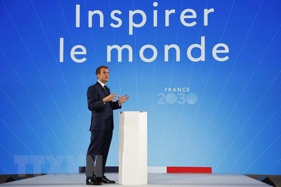 Tổng thống Pháp Emmanuel Macron phát biểu tại hội nghị ở Paris, Pháp, ngày 12/10/2021. (Ảnh: AFP/TTXVN).