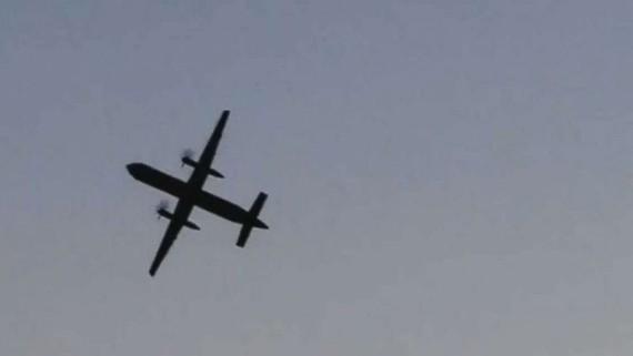Chiếc Q400 của hãng Horizon Air bị lấy trộm bay trên đảo Ketron ở Puget Sound, bang Washington, Mỹ, trước khi đâm xuống đảo này ngày 10-8-2018.  ẢNH:  REUTERS