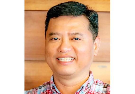 Đối tượng Nguyễn Huỳnh Đăng, nguyên Trưởng phòng kinh doanh Hội sở Ngân hàng TMCP Đông Á. Ảnh BCA.
