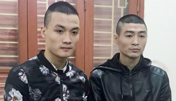 Lê Ngọc Sơn và Cao Văn Quân. Ảnh: Anninhthudo