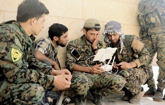 Các tay súng sẽ được đào tạo lại để gia nhập SDF