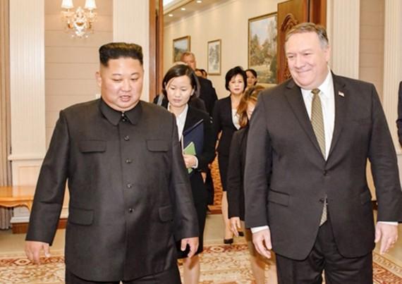Hai bên cam kết sẽ tiếp tục nỗ lực đạt tiến triển về các thỏa thuận đã đạt được trong cuộc gặp thượng đỉnh Mỹ-Triều ở Singapore hồi tháng 6 vừa qua (Ảnh: Yonhap)