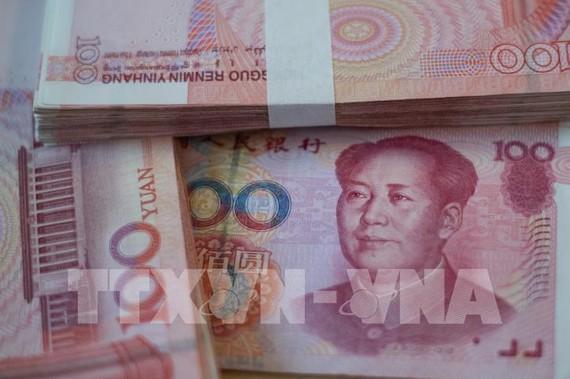 Trung Quốc nâng giá NTD lên mức cao nhất trong 30 tháng