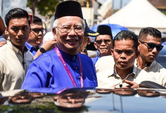 Malaysia's Prime Minister Najib Razak smiles as he leaves after submitting his documents at the nomination centre in Pekan on April 28, 2018. Malaysia's 14th general election is held on May 9 with nominations taking place on April 28. — AFP/VNA Photo