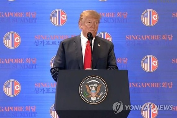 U.S. President Donald Trump speaks during a press conference in Singapore on June 12, 2018, in this photo captured from the website of The Straits Times. (Yonhap)