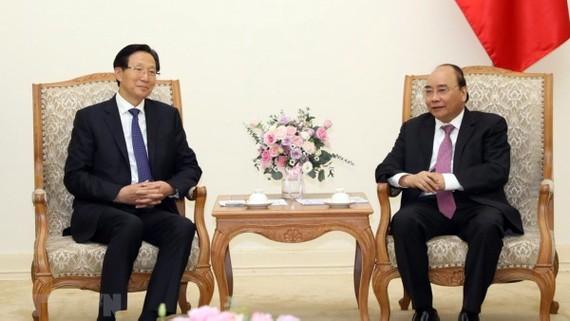 Thủ tướng Nguyễn Xuân Phúc tiếp Bộ trưởng Bộ Nông nghiệp nông thôn Trung Quốc - Hàn Trường Phú. Ảnh: Văn Điệp/TTXVN