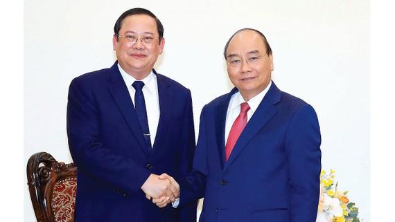 Thủ tướng Nguyễn Xuân Phúc tiếp Phó Thủ tướng kiêm Bộ trưởng Bộ KH-ĐT Lào Sonsay Siphandone. Ảnh: TTXVN