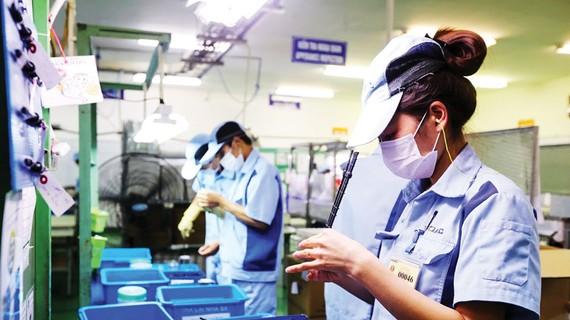 Hoạt động sản xuất tại một doanh nghiệp FDI Nhật Bản. Ảnh: QUANG PHÚC