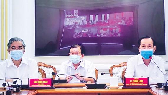 Phó Chủ tịch Thường trực UBND TPHCM Lê Thanh Liêm và Phó Chủ tịch UBND TPHCM Ngô Minh Châu tại buổi giao ban