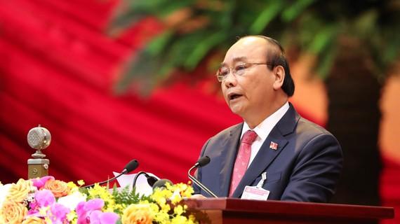 Thủ tướng Nguyễn Xuân Phúc trình bày diễn văn khai mạc Đại hội đại biểu toàn quốc lần thứ XIII của Đảng Cộng sản Việt Nam. Ảnh: VIẾT CHUNG