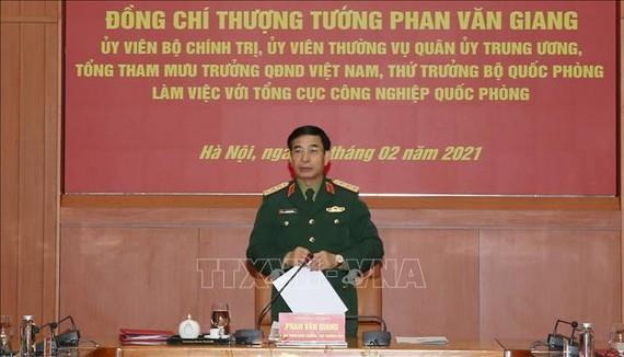 Thượng tướng Phan Văn Giang chủ trì buổi làm việc. Ảnh: TTXVN