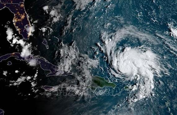 Hình ảnh ghi từ vệ tinh NOAA/RAMMB cho thấy bão Dorian quét qua vùng lãnh thổ Pueto Rico thuộc Mỹ trên vùng biển Caribe ngày 29-8-2019. Ảnh: AFP/TTXVN