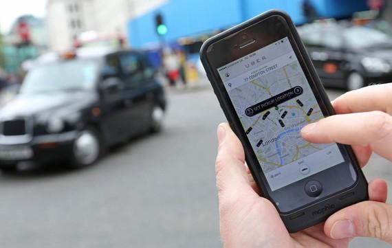  Sở Giao thông London không gia hạn giấy phép Uber hết hạn ngày 30-9-2017 với lý do hoạt động của Uber gây nguy hiểm cho an toàn công cộng. Ảnh: BLOOMBERG