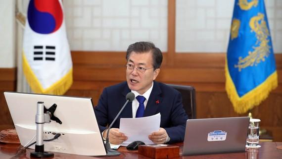 Tổng thống Hàn Quốc Moon Jae-in, ngày 2-1, đề nghị tạo điều kiện cho phái đoàn Triều Tiên tham gia Olympic mùa Đông Pyeongchang 2018. Ảnh : AP