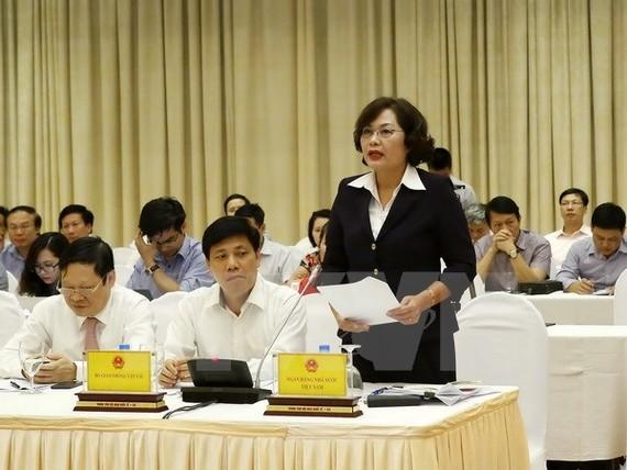 Phó Thống đốc Ngân hàng Nhà nước Nguyễn Thị Hồng trả lời các câu hỏi của phóng viên báo chí.