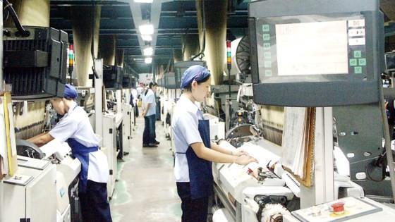 Dây chuyền sản xuất hiện đại tại Công ty Dệt Thái Tuấn. Ảnh: VIỆT DŨNG