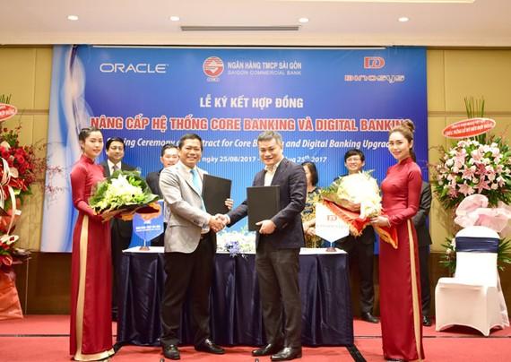 Đại diện SCB và Công ty Dinosys ký kết hợp đồng nâng cấp hệ thống Core Baking và Digital Banking của Oracle