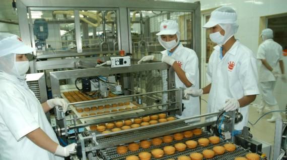 Sản xuất bánh tại Công ty cổ phần Kinh Đô. Ảnh: Cao Thăng
