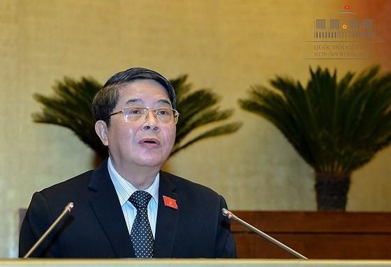 Chủ nhiệm Ủy ban Tài chính ngân sách của Quốc hội Nguyễn Đức Hải trình bày báo cáo thẩm tra Về thí điểm cơ chế, chính sách đặc thù phát triển TPHCM. Ảnh: quochoi