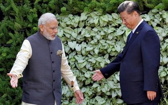 Thủ tướng Ấn Độ Narendra Modi (trái) và Chủ tịch Trung Quốc Tập Cận Bình. Ảnh: REUTERS