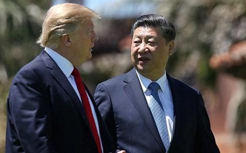 Chủ tịch Trung Quốc Tập Cận Bình (phải) và Tổng thống Mỹ Donald Trump trong chuyến thăm Mỹ tháng 4/2017. (Ảnh: Reuters)