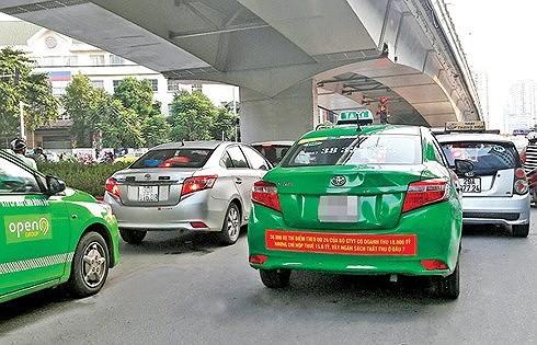 """Theo Bộ trưởng GTVT Nguyễn Văn Thể: """"Taxi truyền thống cũng phải tăng cường công nghệ, phải thích nghi, nếu không cái cũ kỹ sẽ bị đào thải""""."""