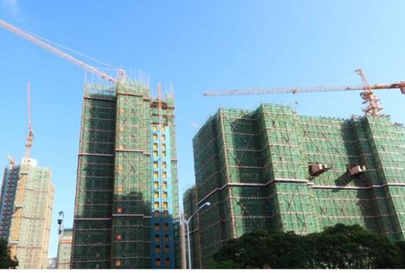 Các tòa nhà đang được xây dựng ở trung tâm thành phố Hạ Môn, tỉnh Phúc Kiến, Trung Quốc. Ảnh: REUTERS